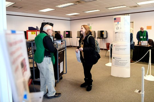 "Maddie Mulhearn receives an ""I voted early"" sticker after early voting for the first time at West Asheville Library February 27, 2020."