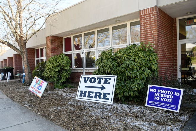 A sign at West Asheville Library directs voters to the polls. Early voting closed on Feb. 29 for the primary election on March 3. Ahead of the election, an Elon Poll measured the sentiments of North Carolina voters.