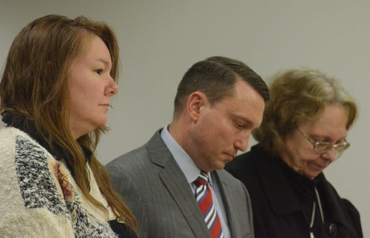 Marcia Lutz, from left, with her attorneys Peter Taylor and Susan Mladenoff.