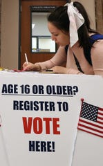 Courtney Haskan, 17, registers to vote at Bremerton High School on Feb. 28. A state law that went into effect last year allows 16-year-old and 17-year-olds to register to vote. Their registration becomes automatic on their 18th birthday.