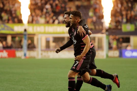 Seattle Sounders midfielder Cristian Roldan, right, celebrates with midfielder Joao Paulo, left, after Roldan scored a goal against Olimpia during the first half of a CONCACAF Champions League soccer match Thursday, Feb. 27, 2020, in Seattle.