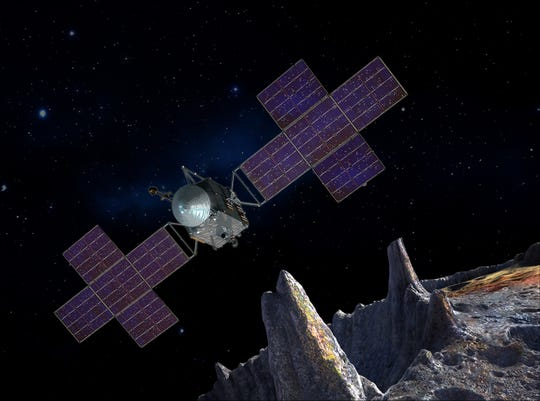 A rendering of NASA's Psyche mission near the metal-rich Psyche asteroid.