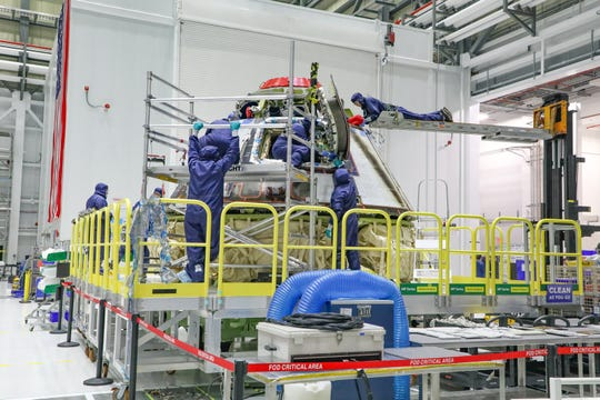 Inside the Starliner production factory at Kennedy Space Center, technicians inspection the Orbital Flight Test crew module after its return from space, and begin the refurbishment process ahead of future flights.