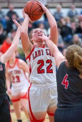 Lucas' Jessie Grover shoots over Buckeye Central's Claudia Pifher.