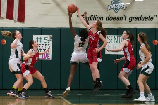 CVU's Catherine Gilwee (4) blocks the shot by Rice's Khadija Hussein (12) during the girls basketball game between the Champlain Valley Union Redhawks and the Rice Green Knights at Rice Memorial High School on Thursday night February 27, 2020 in South Burlington, Vermont.