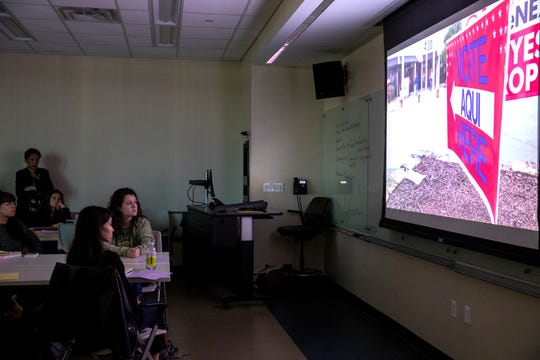 Students in a news literacy class taught by School of Journalism Professor Paula Poindexter at the University of Texas at Austin watch a PBS documentary on new Travis County election machines on Feb. 25, 2020.
