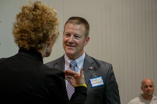 Bruce Hoffbauer, running for Hamilton County Sheriff, speaks with attendees at the Meet the Candidates Night, sponsored by The Cincinnati Enquirer, at Taft's Brewporium in Cincinnati, on Thursday, Feb. 27, 2020.