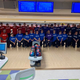 Bowlers from the Greater Catholic League South show off their #ROBBSTRONG shirts at the Division I district tournament Feb. 27, honoring Seton bowling coach Jim Robb who was diagnosed with cancer in November.