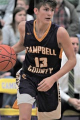 Campbell County senior Jordan Gross eyes the defense as Campbell County defeated Bishop Brossart 55-46 in the KHSAA 37th District boys basketball tournament Feb. 27, 2020 at Campbell County Middle School, Alexandria, Ky.