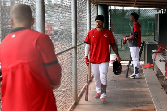 Cincinnati Reds non-roster invitee infielder Jonathan India walks in the dugout, Sunday, Feb. 23, 2020, at the baseball team's spring training facility in Goodyear, Ariz.