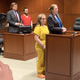 Lindsay Parker, in yellow, and her father, Bryan Parker, in red, were each sentenced for six to nine years for felonious assault in an assault on Lindsay's ex-boyfriend that left him hospitalized.