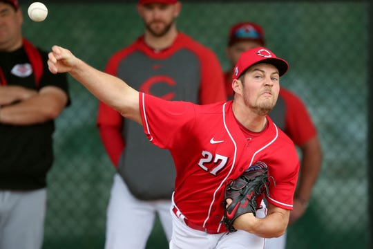 Cincinnati Reds starting pitcher Trevor Bauer (27) delivers in the bullpen, Sunday, Feb. 23, 2020, at the baseball team's spring training facility in Goodyear, Ariz.