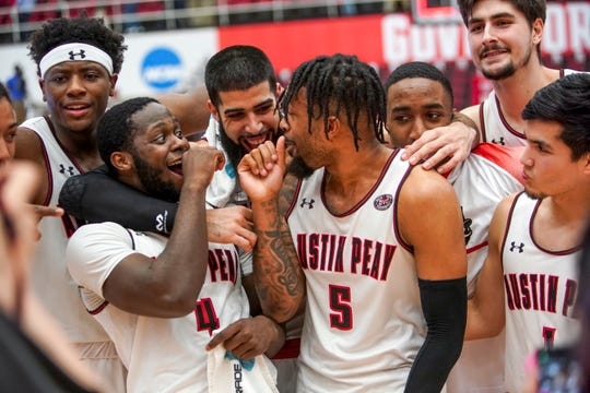 APSU players huddle together and joke with one another after winning in an OVC basketball game between the Austin Peay Governors and  at the APSU Dunn Center in Clarksville, Tenn., on Thursday, Feb. 27, 2020.