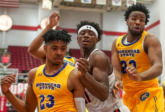 APSU's Terry Taylor (21) bunches up with Morehead's Malik Riddle (22) and LJ Bryan (22) watching a loose ball in an OVC basketball game between the Austin Peay Governors and  at the APSU Dunn Center in Clarksville, Tenn., on Thursday, Feb. 27, 2020.