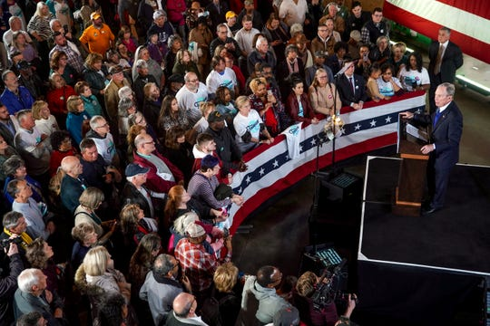 Mike Bloomberg stands at the podium overlooking supporters at a Bloomberg campaign rally at Old Glory Distilling Co. in Clarksville, Tenn., on Friday, Feb. 28, 2020.