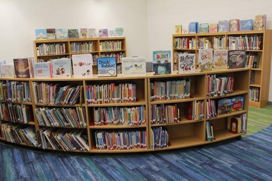 The new bookshelves were restocked by volunteers from Parent Teacher Organization