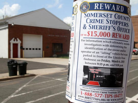 A reward poster was placed outside Lincoln Hose Company No. 4 where George Kavanaugh was killed by a driver March 6, 2015.