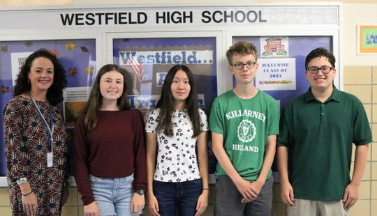 Four Westfield High School seniors have advanced as finalists in the 2020 National Merit Scholarship Program, having met academic and other standards to become eligible for scholarships which will be announced in the spring. The program honors students who show exceptional academic ability and potential for success in rigorous college studies.   Pictured here in September with principal Mary Asfendis are (from left) Julia Tompkins, Connie Liu, Aidan Kilbourn and Ian Gurland.