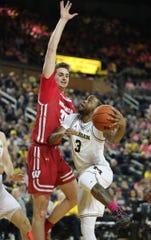 Michigan guard Zavier Simpson drives against Wisconsin forward Nate Reuvers during the first half Thursday, Feb. 27, 2020 at the Crisler Center in Ann Arbor.
