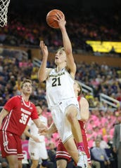 Michigan's Franz Wagner scores against Wisconsin during the second half Thursday, Feb. 27, 2020 at the Crisler Center in Ann Arbor.