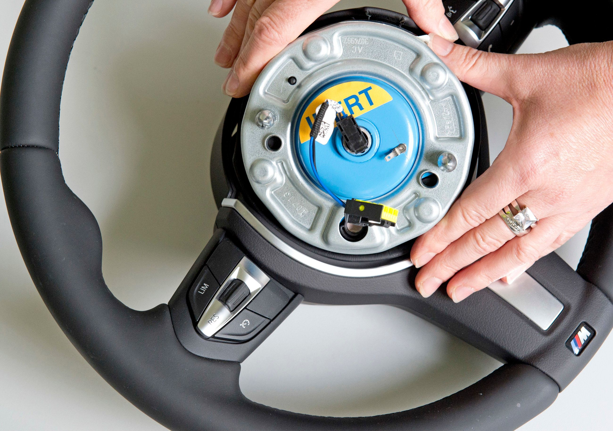 A worker demonstrates a pyro-electric wheel airbag initiator during a presentation for journalists at the international automotive supplier Takata Ignition Systems in 2014. Takata acknowledged in 2015 that it had supplied defective airbags for use in millions of vehicles.