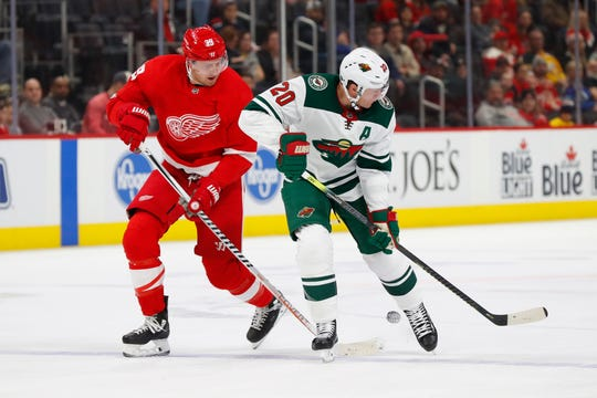 Detroit Red Wings right wing Anthony Mantha and Minnesota Wild defenseman Ryan Suter battle for the puck in the second period Thursday, Feb. 27, 2020, in Detroit.