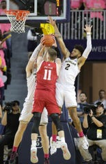 Michigan's Isaiah Livers (2) and Jon Teske defend Wisconsin's Micah Potter during the second half Thursday, Feb. 27, 2020 at the Crisler Center in Ann Arbor.