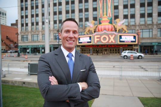 Christopher Ilitch, of Ilitch Holdings, Inc., stands in front of the Fox Theatre marquee, during the relighting event in Detroit on Thursday, Oct. 15, 2015.