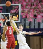 Michigan's Jon Teske (15) defends Wisconsin's D'Mitrik Trice during the second half Thursday, Feb. 27, 2020 at the Crisler Center in Ann Arbor.