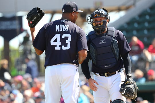 Tigers starting pitcher Ivan Nova talks with catcher Austin Romine during the first inning on Friday, Feb. 28, 2020, in Lakeland, Florida.