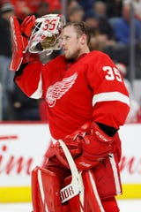 Detroit Red Wings goaltender Jimmy Howard puts his helmet on during the first period against the Minnesota Wild, Thursday, Feb. 27, 2020, in Detroit.