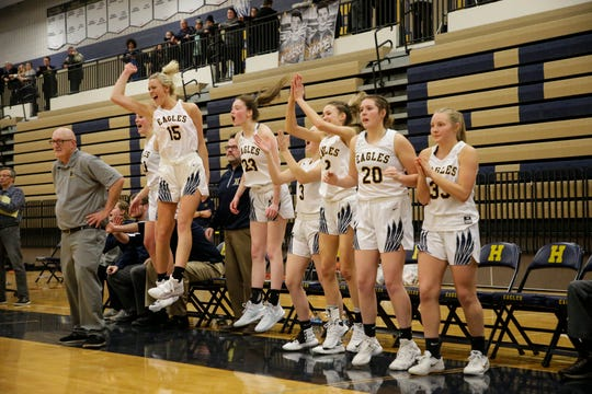 Hartland's bench erupts in excitement during the district final game against Brighton.