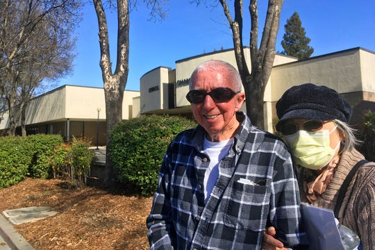 Eugenia Kendall, right, wears a mask outside of the Vacaville City Hall while standing with her husband, Ivan, Thursday, Feb. 27, 2020, in Vacaville, Calif. On Wednesday, the U.S. Centers for Disease Control and Prevention confirmed a case of coronavirus in Solano County, California.