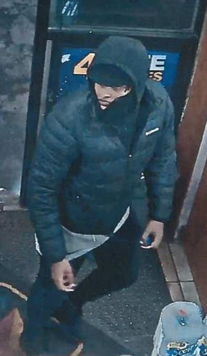 Detroit police released an image of the suspect who is being sought for luring victims to a location with an online dating app and then robbing them at gunpoint.