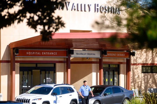 A security guard leaves NorthBay VacaValley Hospital, where a woman diagnosed with coronavirus previously sought treatment, on Thursday, Feb. 27, 2020, in Vacaville, Calif.