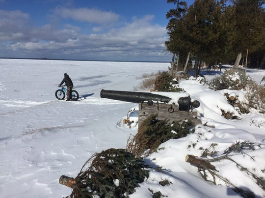 Fat tire biking on frozen Lake Huron at the British Landing is one recreational pursuit available to winter visitors on Mackinac Island.