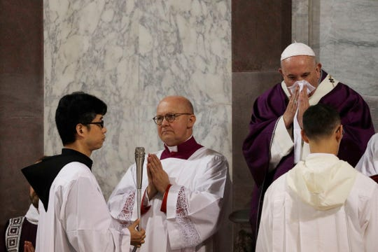Pope Francis wipes his nose during the Ash Wednesday Mass opening Lent at the Basilica of Santa Sabina in Rome.