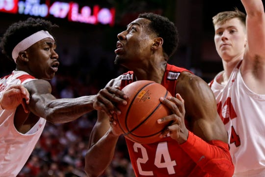 Ohio State's Andre Wesson (24) is defended by Nebraska's Cam Mack, left, and Thorir Thorbjarnarson (34).