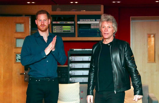 Britain's Prince Harry meets Jon Bon Jovi and members of the Invictus Games Choir during his visit Abbey Road Studios in London, Friday, Feb. 28, 2020.