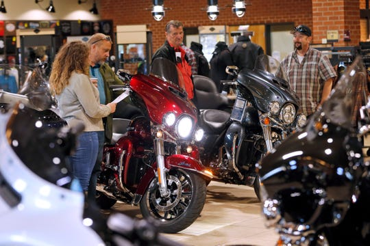 Customers look over Harley-Davidson motorcycles on display at a dealership in Ashland, Va. U.S. consumer sentiment remained elevated in the second half of February despite the intensifying coronavirus fears that have battered equity markets, a UM survey finds.