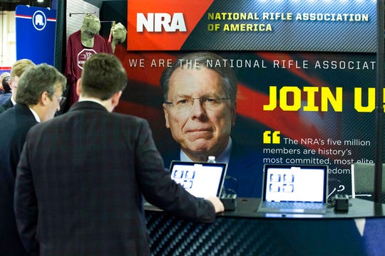 People at the NRA booth at CPAC 2020, at the National Harbor, in Oxon Hill, Md., Thursday, Feb. 27, 2020.