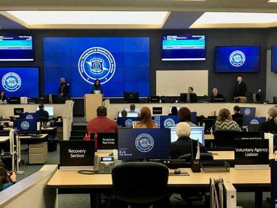 Gov. Gretchen Whitmer addresses staff in the emergency operations center on Friday.