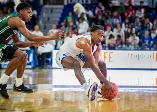 FGCU's Jalen Warren collects the ball against Jacksonville at Alico Arena on Feb. 27.