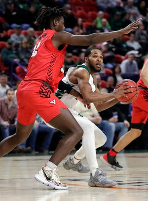 UWGB guard JayQuan McCloud knows his team must contain Oakland's post players Thursday in a Horizon League quarterfinal game at the Resch Center.