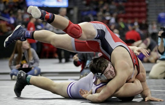 Kiel High School's Jason Klauck against Neillsville/Greenwood/Loyal's Gunner Hoffmann in a 220-pound Division 2  preliminary match during the WIAA individual state wrestling tournament on Thursday, Feb. 27, 2020, at the Kohl Center in Madison, Wis.