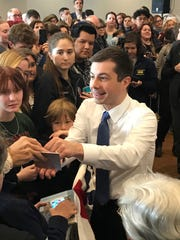Democratic presidential candidate Pete Buttigieg greets supporters after a rally at The Citadel's Holliday Alumni Center in Charleston Friday, Feb. 28, 2020, one day before the South Carolina primary election.