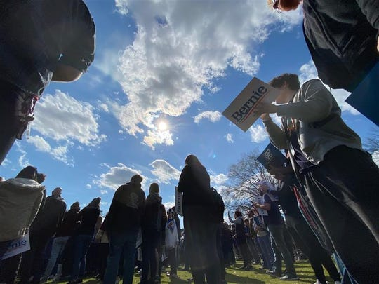 People wait outside to attend a rally for U.S. Sen. Bernie Sanders, in Columbia, Friday, Feb. 28, 2020.