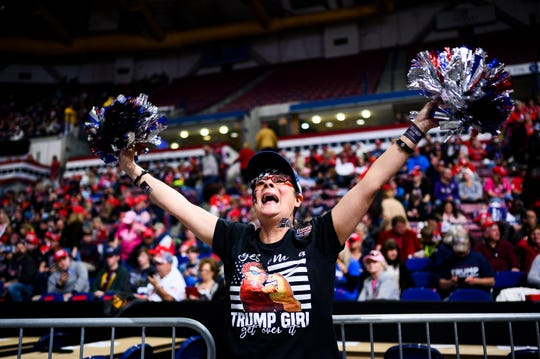 Debra Jones of Summerville cheers as she and other supporters of President Donald Trump wait for a rally to begin at the North Charleston Coliseum Friday, Feb. 28, 2020.