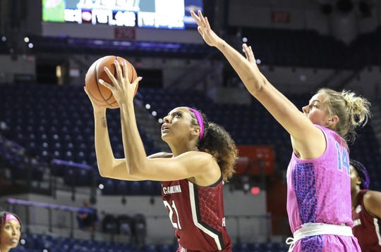 South Carolina forward Mikiah Herbert Harrigan (21) shoots while defended by Florida guard Kristina Moore (14) during the first half of an NCAA college basketball game Thursday, Feb. 27, 2020, in Gainesville, Fla. (AP Photo/Gary McCullough)