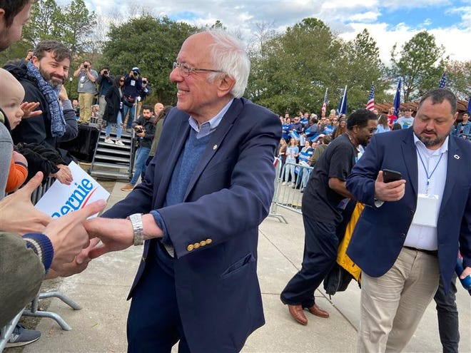 Bernie Sanders greets people after a rally in South Carolina on Feb. 28, 2020.